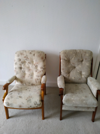 Two solid wood framed chairs