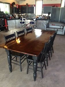Antique harvest table with 6 chairs.