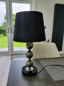 Table lamp with black shade.