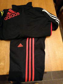 2 boys Adidas tracksuits and a extra pair of tracksuit bottoms