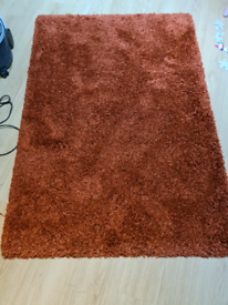 Dunelm rusty red shaggy rug