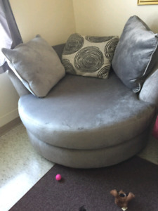 Grey round swivel chair