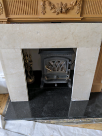 Solid marble fire surround in cream beige colour