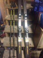 Head Cyber XIS skis with Salomon C710 bindings & Gabel poles