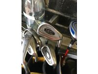 Two sets of golf clubs