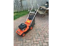 Briggs and Stratton petrol lawn mower.