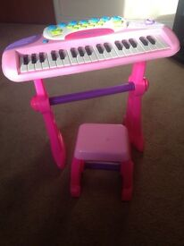 Child's piano and stool