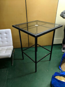 Bar height glass patio table