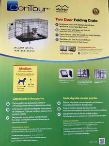 Cage chien moyenne comme neuve, 31 pouces long par 21.5 haut.