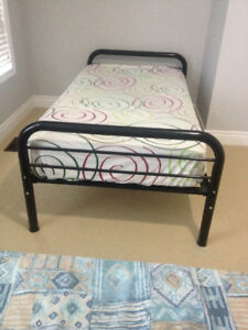 black single solid metal bed frame with firm mattress excellent