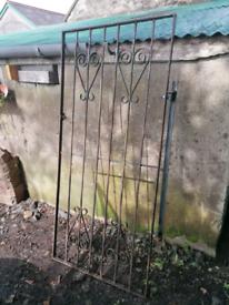 Tall garden gate for alley way or narrow entrance.
