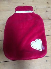 Red love-heart hot water bottle cover