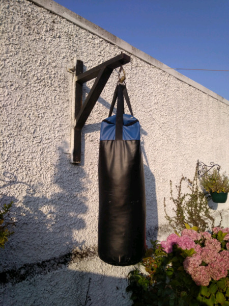 Boxing Bag and Wall Bracket and 1 large pair and 1 small pair of gloves