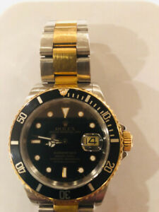 ROLEX two tone Black 40mm Submariner Date 18k yellow gold 16613