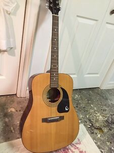 Acoustic guitar with delivery