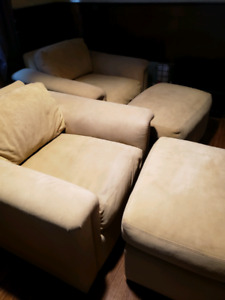 Goat skin leather, down filled arm chairs and ottomans