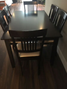 Dining Table + 6 chairs for sale.
