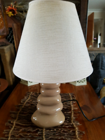 Table or bedside lamp with ceramic pebble base