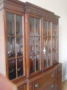 Elegant beautiful hutch with beveled panes and built in desk.