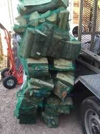 10 Netted bags of firewood / logs for sale