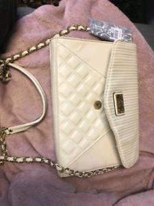 Kardashian kollection - cream large clutch bag.