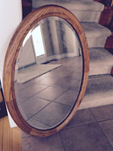 """Solid Oak Oval Mirror- 34"""" tall 24"""" at widest point in width."""