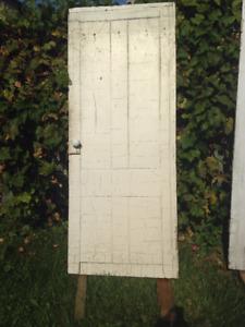Antique door with porcelain door nobs
