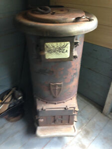 Wood Stove including insulated stove pipe