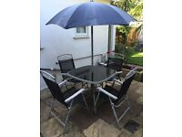 Garden table and 4 chairs and umbrella