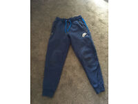 Nike Air jogging bottoms size Small adult