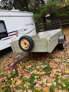 Utility Trailer with Ramp and Manual Dump