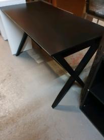 A stylish good quality black wooden desk.