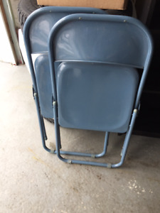 Metal folding chairs.