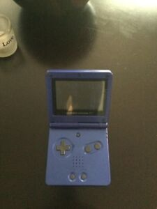 for sale game boy advanced sp comes with one game and charger.