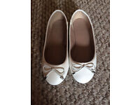 White flat pumps size 4