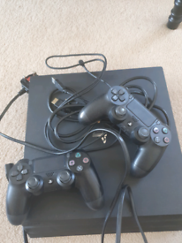 Playstation 4 Pro with 2 controllers