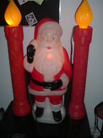 3 FEET PLASTIC SANTA CLAUS AND 2 NOEL CANDLES WITH LIGHTS