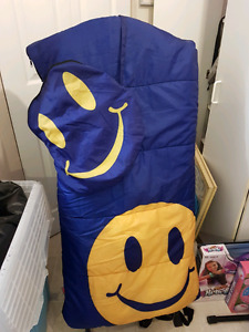 Happy face sleeping bag with carrying case