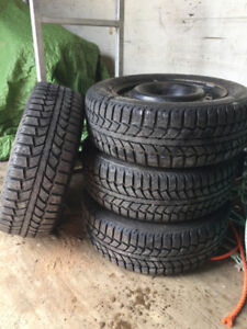 4 Tiger Paw Snow & Ice Tires with steel rims