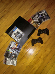 PS3 slim complete working sysrem with 7 game shooter pack 150$