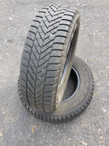 Set of 2 Winter Tires 185/70R14 Goodyear Ultragrip Ice for sale.