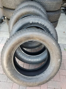 FOUR FIRESTONE TRANSFORCE LT LOAD RANG E 20 in HEAVY DUTY TIRES