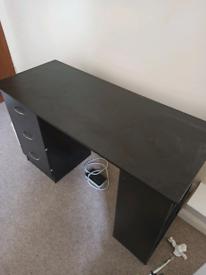 Wide black wooden desk + swivel chair