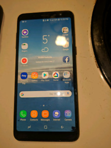 Samsung A8 Cell Phone And Otter Box