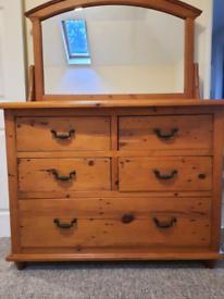 Solid dark pine set of drawers topped swing mirror
