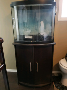 44 Gallon curved fish tank with matching stand $150 firm