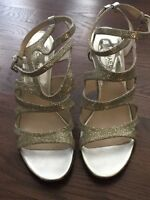 Silver Glittery strappy  Michael Kors heeled sandals.