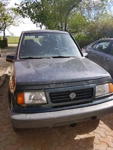 1995 Suzuki  Sidekick............phone calls only 403 922 6199