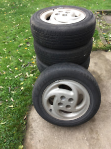 "Selling 4 x 15"" alloy rims from Saturn SL2 with tires"