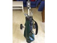 Assorted golf clubs and bag trolley
